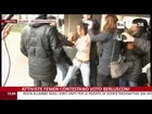 Topless women protest against Berlusconi as he votes in election