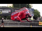 Double Decker Bus Doing Push ups in London by David Cerny Czech House